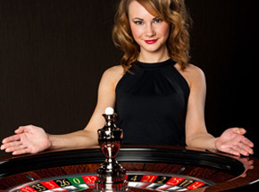 Women standing behind roulette wheel